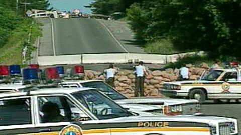 Surete du Quebec (SQ) establish blockade down hill from Mohawk warrior blockade, June 11, 1990.