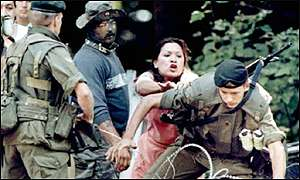 A Native woman pushes soldier into razor wire at Kanesatake.