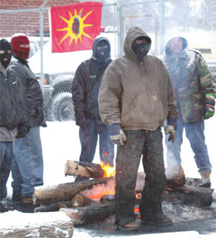 Masked warriors during 2004 eviction of police from Kanesatake.