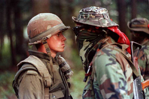 Warrior and Canadian soldier face off during the Oka Crisis of 1990.