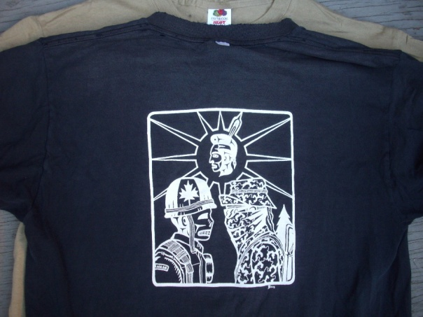 One of two new designs, this one features the iconic image from the 1990 Oka Crisis depicting a masked and armed warrior confronting a Canadian soldier.