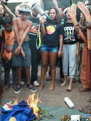 Aboriginals burn Australian flag during protests in 2012.