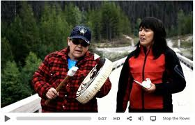 Freda Huson (right) with drummer on bridge near Unistoten camp in Wetusuwet'en territory.