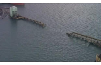 A section of trestle that moved coal to ships at the port is damaged.