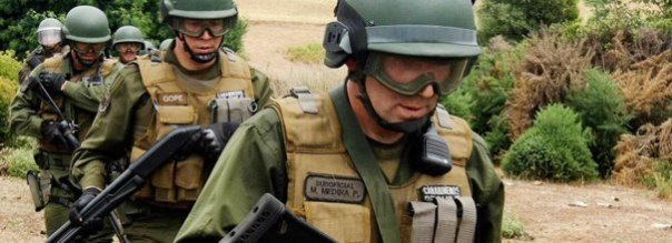 Members of Chilean special police force raid Mapuche community on Dec 22, 2012.
