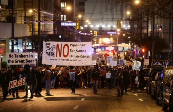 Protesters march against Enbridge hearing in Vancouver, Jan 14, 2013.