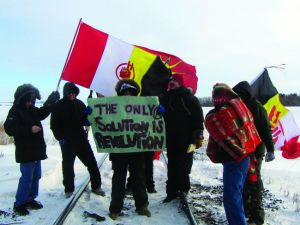 Train blockade at Portage la Prairie, Manitoba, Jan 16, 2013. AIM flag in background.