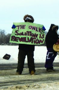 Protester at temporary train blockade, Portage la Prairie, Manitoba, Jan 16, 2013.