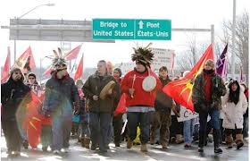 INM protesters temporarily block New York State-Ontario border.  Mohawks from Akwesasne marched across two bridges into Cornwall, Ont., where they held a round dance.  Jan 5, 2013.