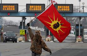 One of the few expressions of militancy as INM protesters temporarily block the Blue Water Bridge border crossing to the United States in Sarnia, Ont, Jan 5, 2013. The closing of the bridge lasted about an hour.