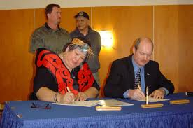 Judith Sayers as chief of Hupacasath band council, signing economic development deal with BC government.