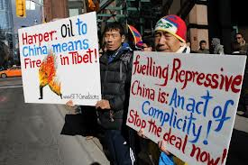 Tibetans protest sale of Nexen to Chinese corporation; fueling repression.