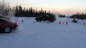 Attawapiskat members use vehicles to block ice road to De Beers Victor mine.