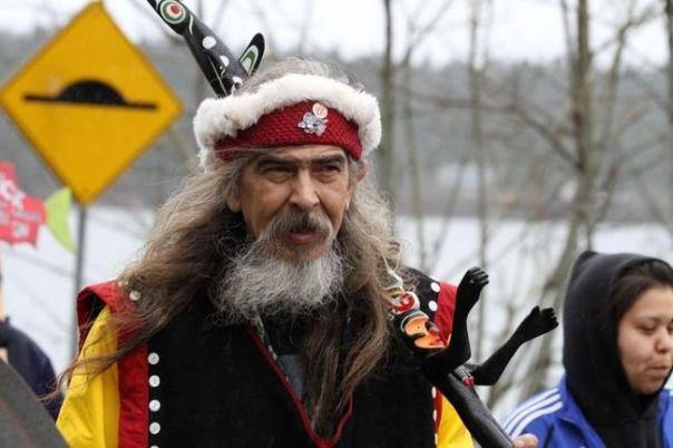 Namgis hereditary chief Beau Dick walking to Victoria legislature.