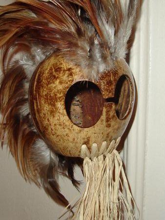 Modern replica of traditional Hawaiian helmet, made of coconut.