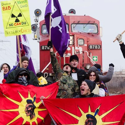 Natives and anti-nuclear activists temporarily blockade CP Railway train in Toronto, Feb 3, 2013.