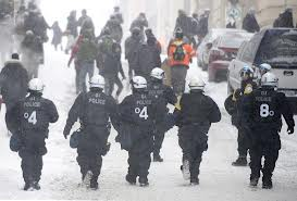 Riot cops chase protesters during Feb 9, 2013 protest.