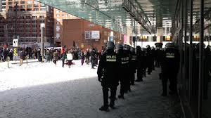 Montreal riot cops protest the Palais de Congress.