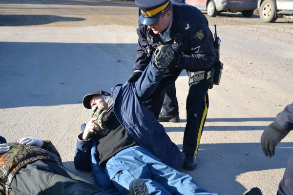 Inuit Elder James Learning is dragged by Royal Canadian Mounted Police to one of their vehicles upon his arrest on April 5, 2013, for refusing to stop participating in a blockade to protest the Muskrat Falls hydroelectric project on the Lower Churchill River in Labrador, Canada.