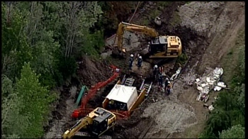 Kinder Morgan workers at site of June 12 oil spill.