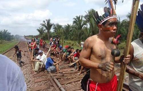 Indigenous people in Brazil block a railway during protests against new legislation, Oct 2, 2012.