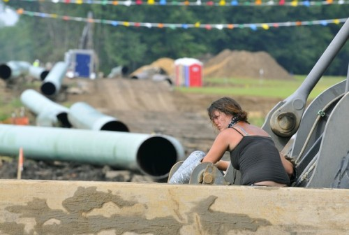 A member of MICAT locked down to machinery in Michigan, July 22, 2013.