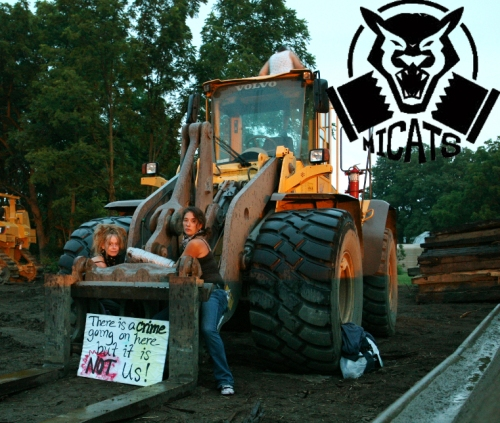 Members of Michigan Against Tar Sands locked down to machinery used by Enbridge in pipeline construction, July 22, 2013.