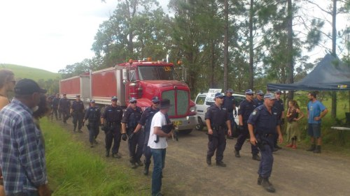 Feb 2013 Australia anti-fracking protests see police escort for drilling company trucks.