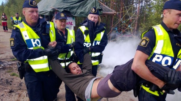 Protester arrested by police in Sweden while protecting Sami territory.
