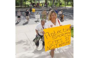 Protesters and supporters of resource development on Thunderchild First Nation gathered outside the Saskatoon Court of Queen's Bench on Aug. 16, 2013.