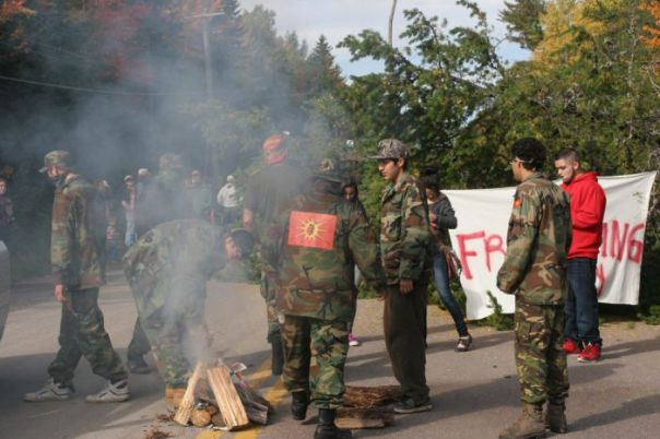 Warriors build fire on road during blockade of SWN vehicles, Oct 2013.