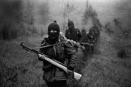 Zapatista fighters on patrol in Chiapas forest.