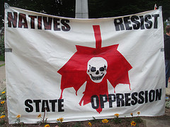 Banner for Anti-Canada Day of Action, 2008, Vancouver BC (Coast Salish Territory).