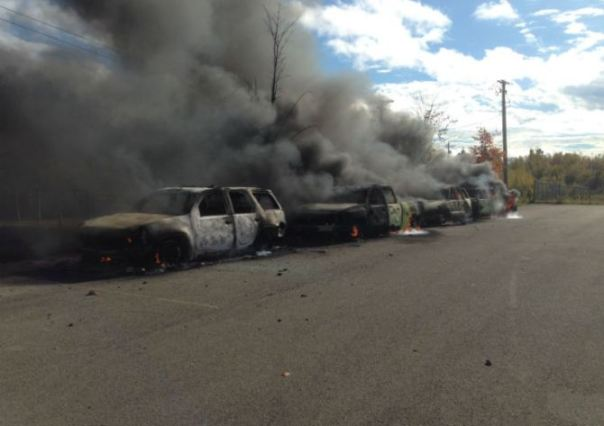 RCMP vehicles burn following Oct 17, 2013 raid on anti-fracking blockade near Rexton, New Brunswick.