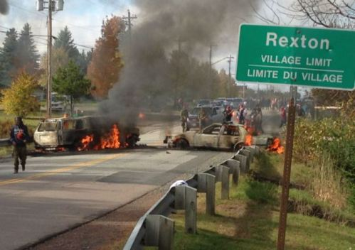 Two police vehicles torched, Oct 17, 2013.