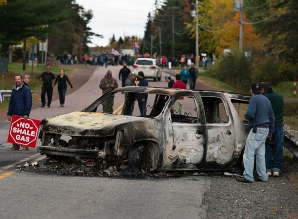 Burnt RCMP vehicle after Oct 17, 2013, raid.