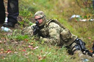 RCMP ERT member providing cover fire for Tactical Troop, Oct 17, 2013.