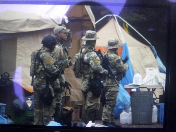 Members of RCMP Emergency Response Team in encampment, Oct 17, 2013.