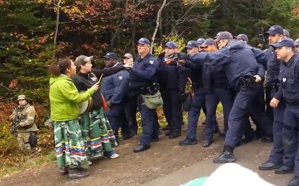 In this photo from Oct 17, you can see how bulky these cops appear as they are wearing protective armour.