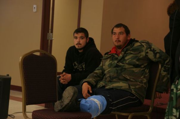 Tyson Peters, a member of the Mi'kmaq Warrior Society, was shot in the leg with a projectile fired by RCMP and risks losing his leg as a result.