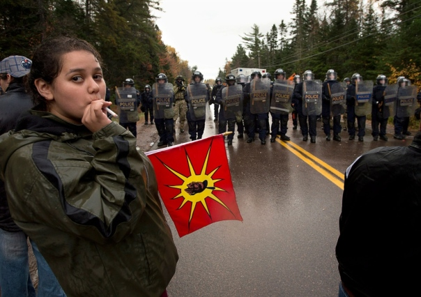 Mi'kmaq face RCMP riot cops on Oct 17, 2013, near Elsipogtog, NB.