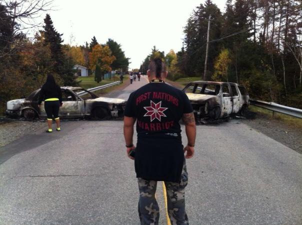 Aftermath of police raid and burned out RCMP vehicles, Oct 17, 2013.