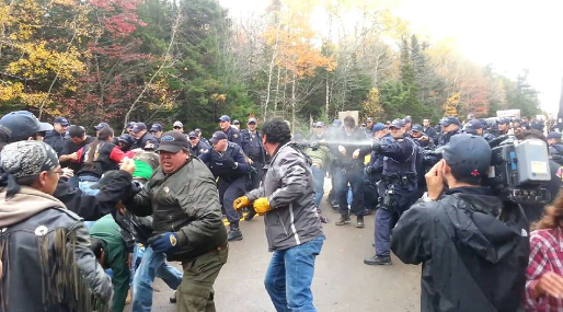 RCMP pepper spray crowd at blockade near Rexton, New Brunswick, Mi'kmaq territory, Oct 17, 2013.