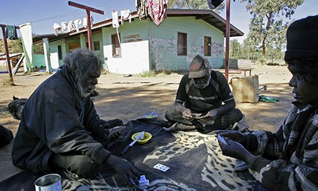 Aboriginal elders playing cards in their camp near Alice Springs.