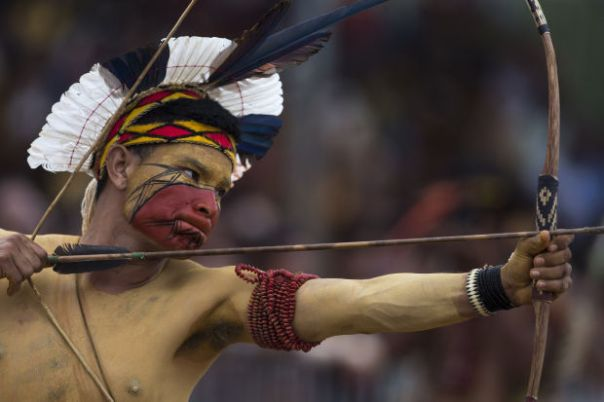 A Pataxo Indian takes part in the bow and arrow competition during the indigenous games in Cuiaba, Brazil, Tuesday, Nov. 12, 2013.
