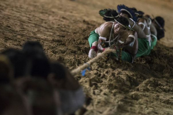 Gaviao Indians participate in a tug of war competition during the indigenous games in Cuiaba, Brazil, Wednesday, Nov. 13, 2013.