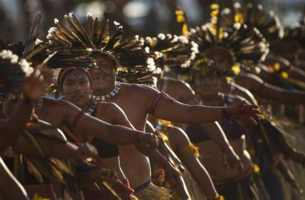 Bororo Indians perform a traditional ritual during the 12th Indigenous Games in Cuiaba, Brazil, Thursday, Nov. 14, 2013.