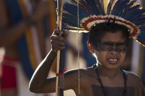A Manoki Indian boy reacts in pain after having his nose pierced as part of a coming of age ritual during the 12th Indigenous Games in Cuiaba, Brazil, Thursday, Nov. 14, 2013.