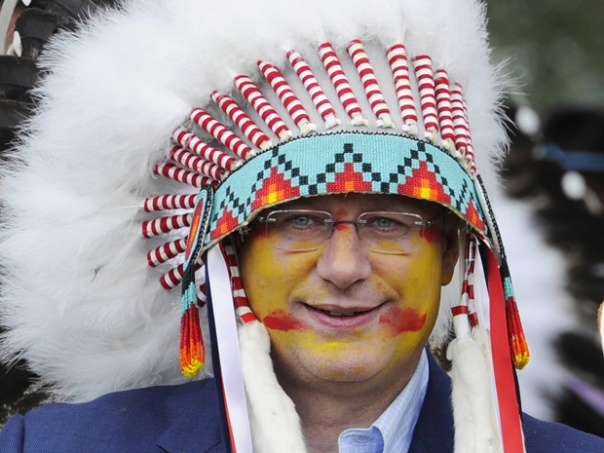 Harper wearing headdress supplied by Blood band council, 2011.