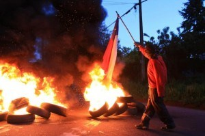Mapuche road block with burning tires, Dec 2012.